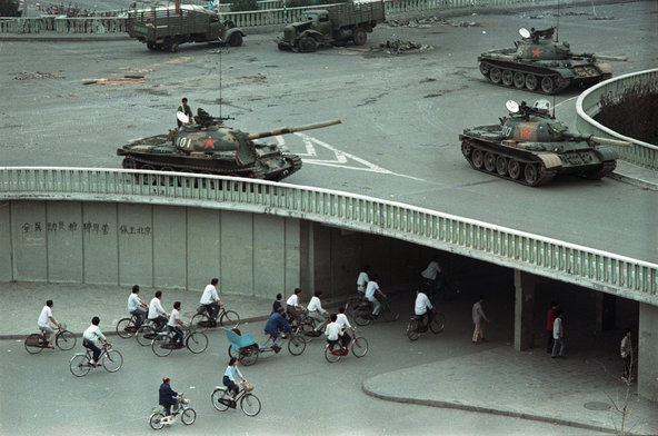 Army tanks hold positions on an overpass in Beijing on June 6, 1989, two days after the crushing of the Tiananmen Square demonstrations.Credit Vincent Yu/Associated Press